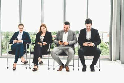 Businesswomen And Businessmen Using Mobile Phone.