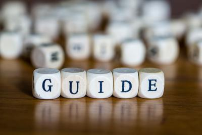 Word Guide Written With Wooden Cubes Text