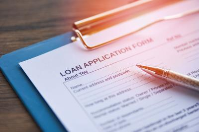 Loan Application Form With Pen On Paper / Financial Loan Negotiation For Lender And Borrower On Busi