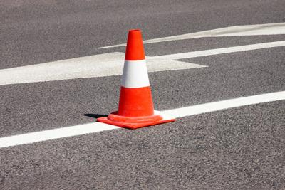 Work On Road. Construction Cone. Traffic Cone, With White And Orange Stripes On Asphalt. Street And
