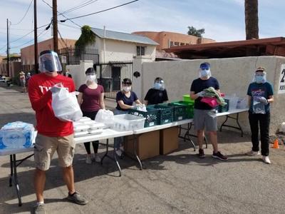 volunteers_handing_out_food.jpg