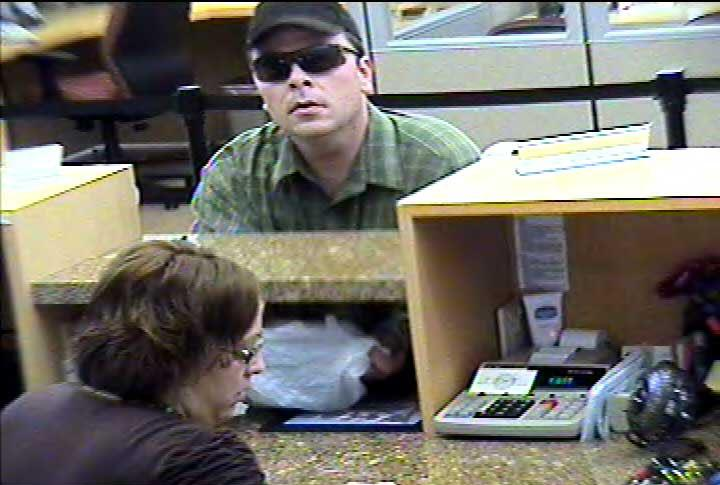 Suspect in credit union robbery at large