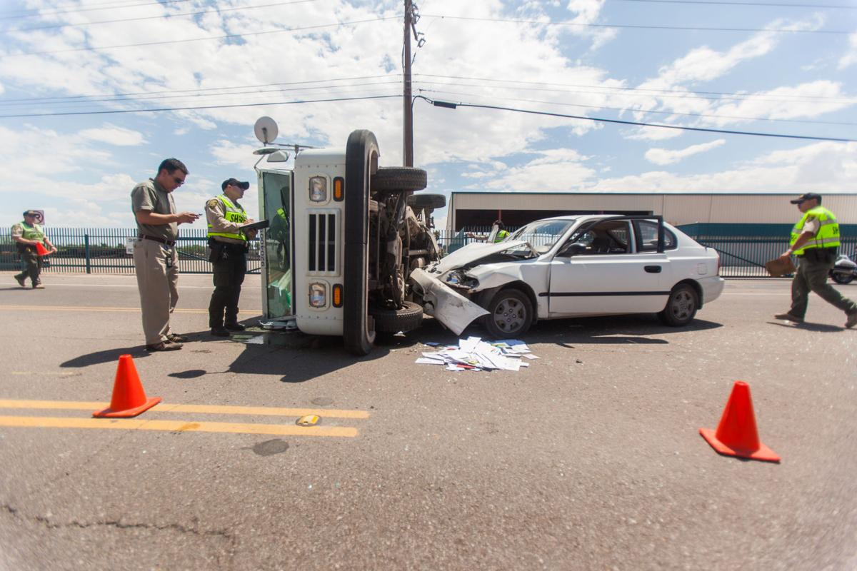 Rollover involving mail truck injures one