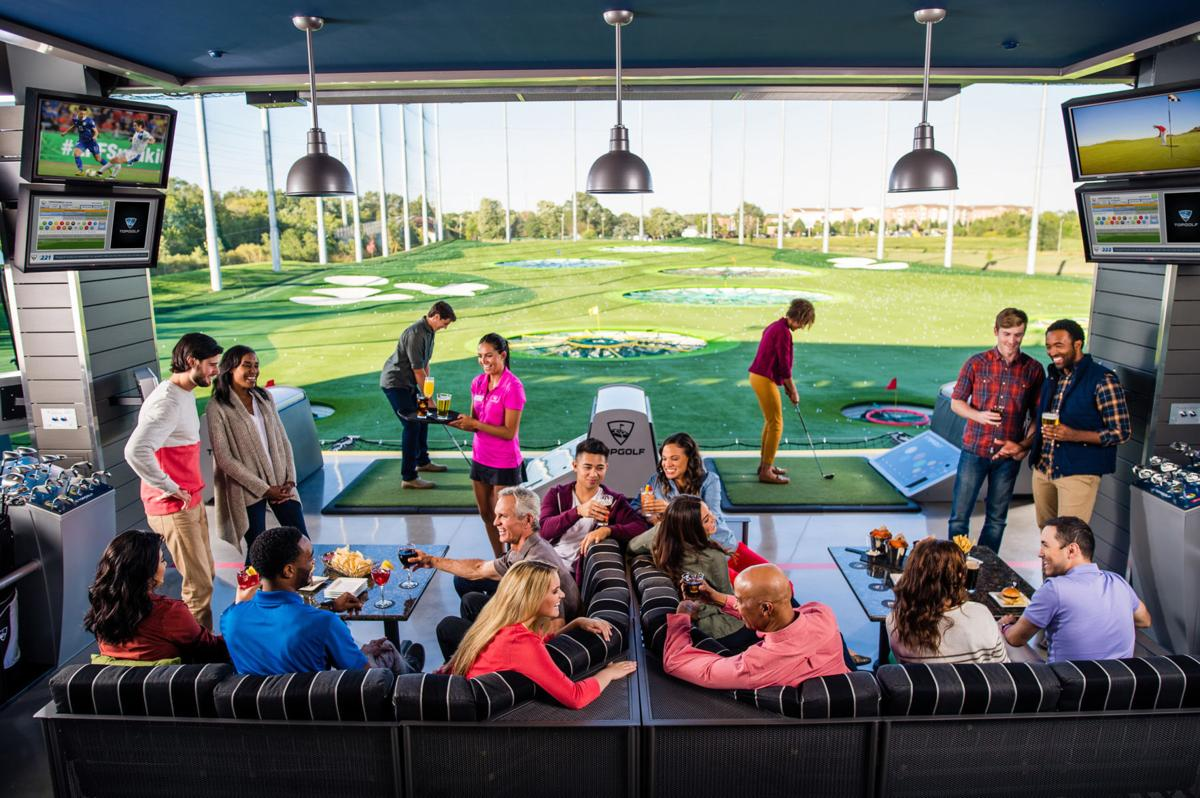 Guests playing at Topgolf