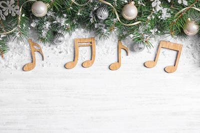 Flat Lay Composition With Christmas Decor And Music Notes On White Wooden Table, Space For Text