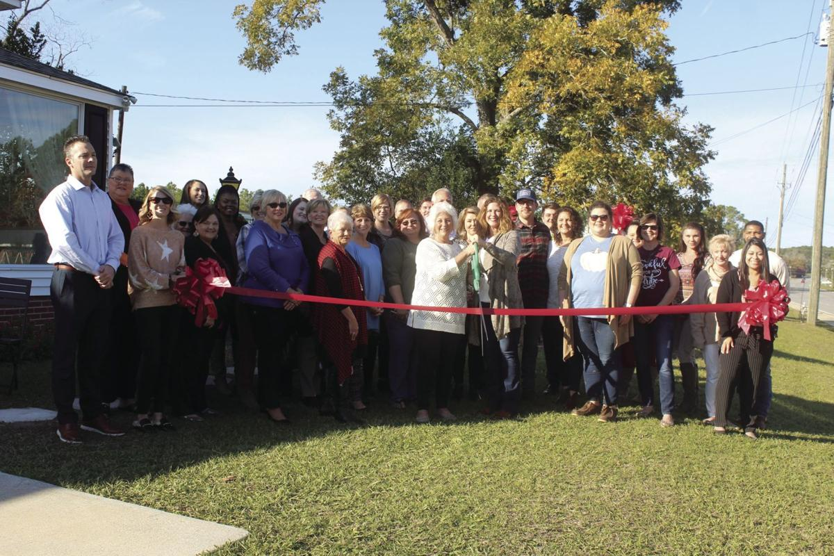 Two Biddies, a vintage and new home decor and gift shop, held a ribbon cutting and open house on Thursday, Nov. 21 at the 3020 N. Tift Ave. location.