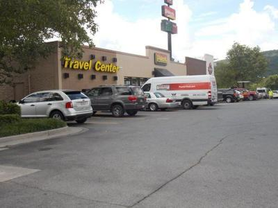 1 man in jail, 3 others wanted after robbery of trucker at the Pilot Travel Center
