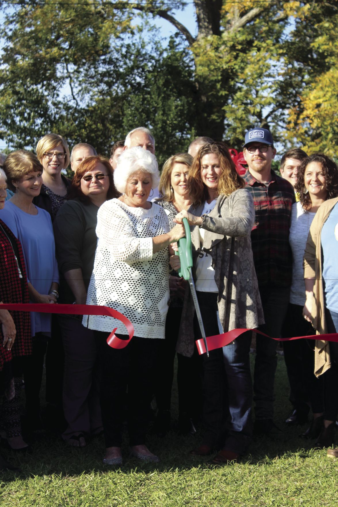 Faye Brannon and Allison McGriff cut the ribbon for their store.