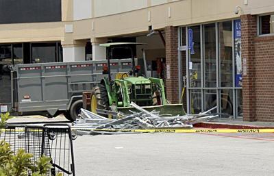 Car hits grocery store; gunshot victim found in vehicle