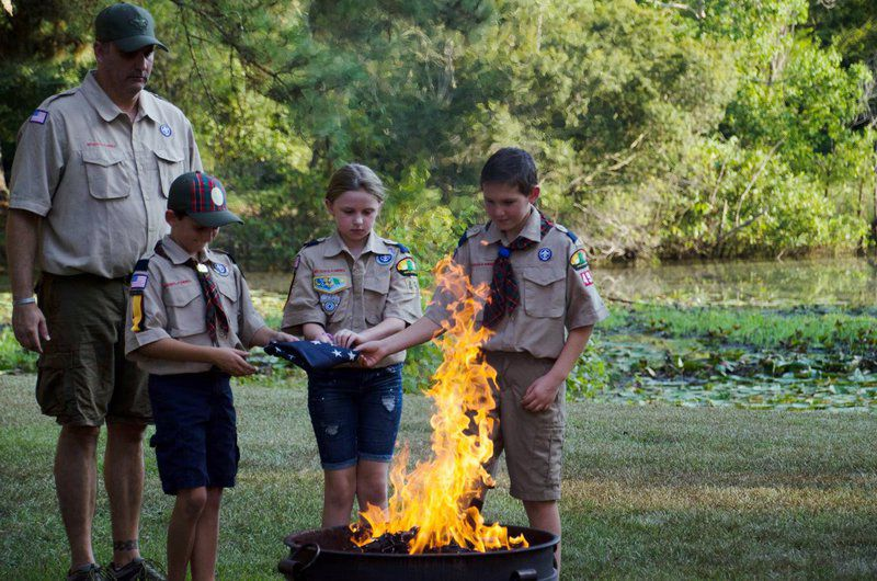 Daughters, scouts retire flags