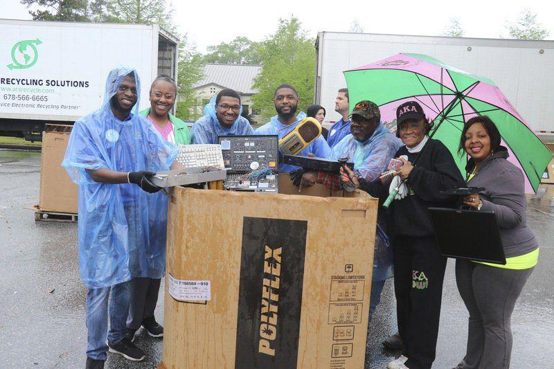 Volunteers work recycling event