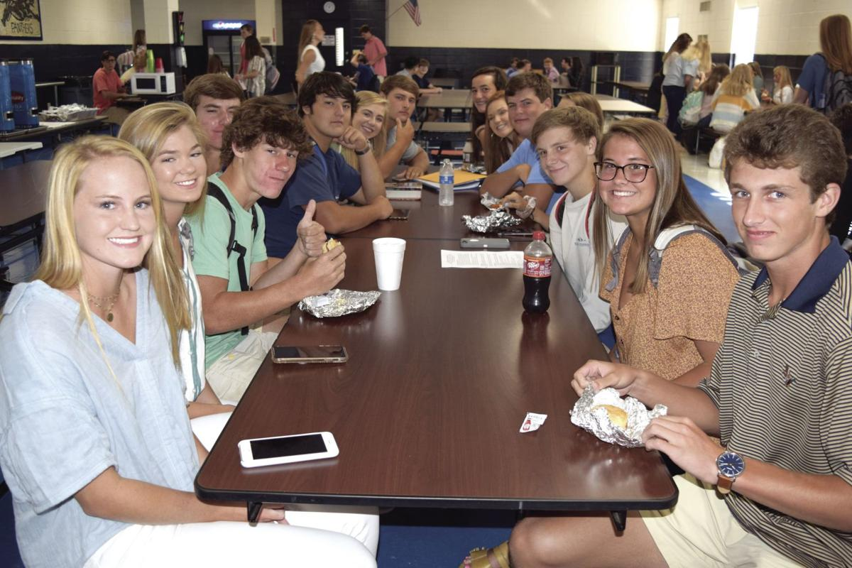 A group of high schoolers are ready for their first day of school to get underway.