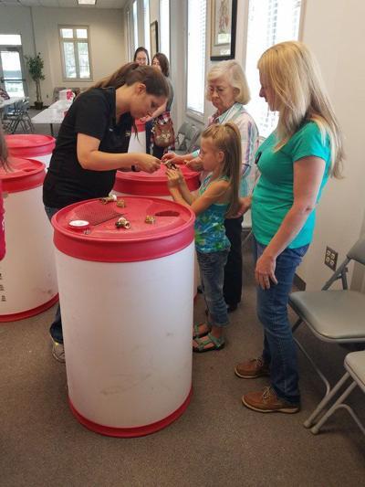 Residents construct free rain barrels