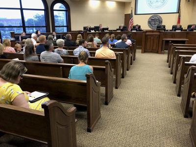 Packed crowd opposes rezoning