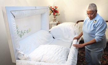 Mary Stevens With Funeral Home Looks Over A Casket Being Prepared For Family Valdosta Daily Times