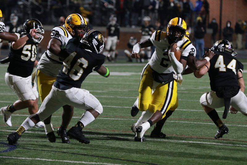 Breaking Through: 'Cats romp Trojans to reach state semis