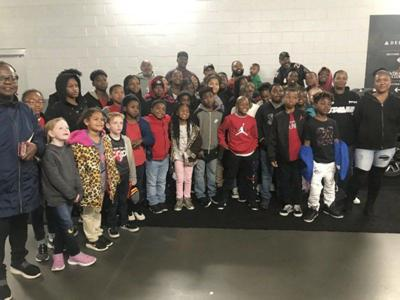 Falcons player, Cairo native gives present to Boys & Girls Club members