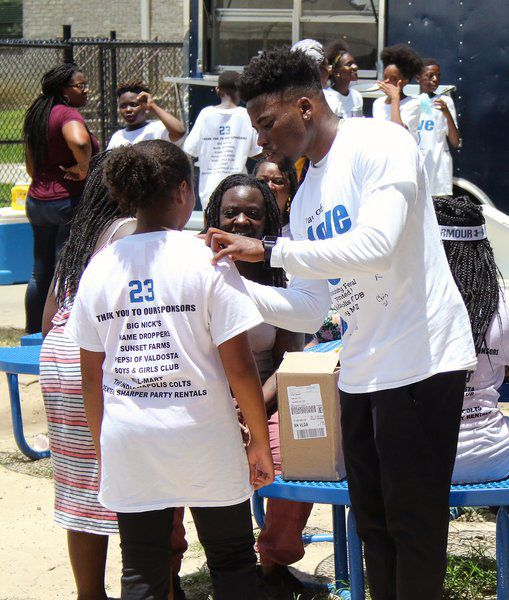 premium selection 85c73 e0324 A Day of Love: Colts CB Kenny Moore hosts festival | Local ...