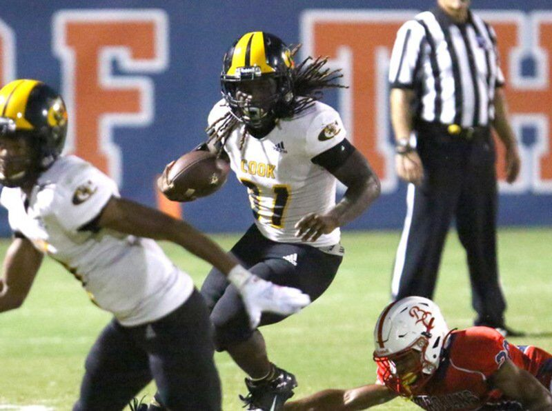 Trojans cruise past Hornets for first win