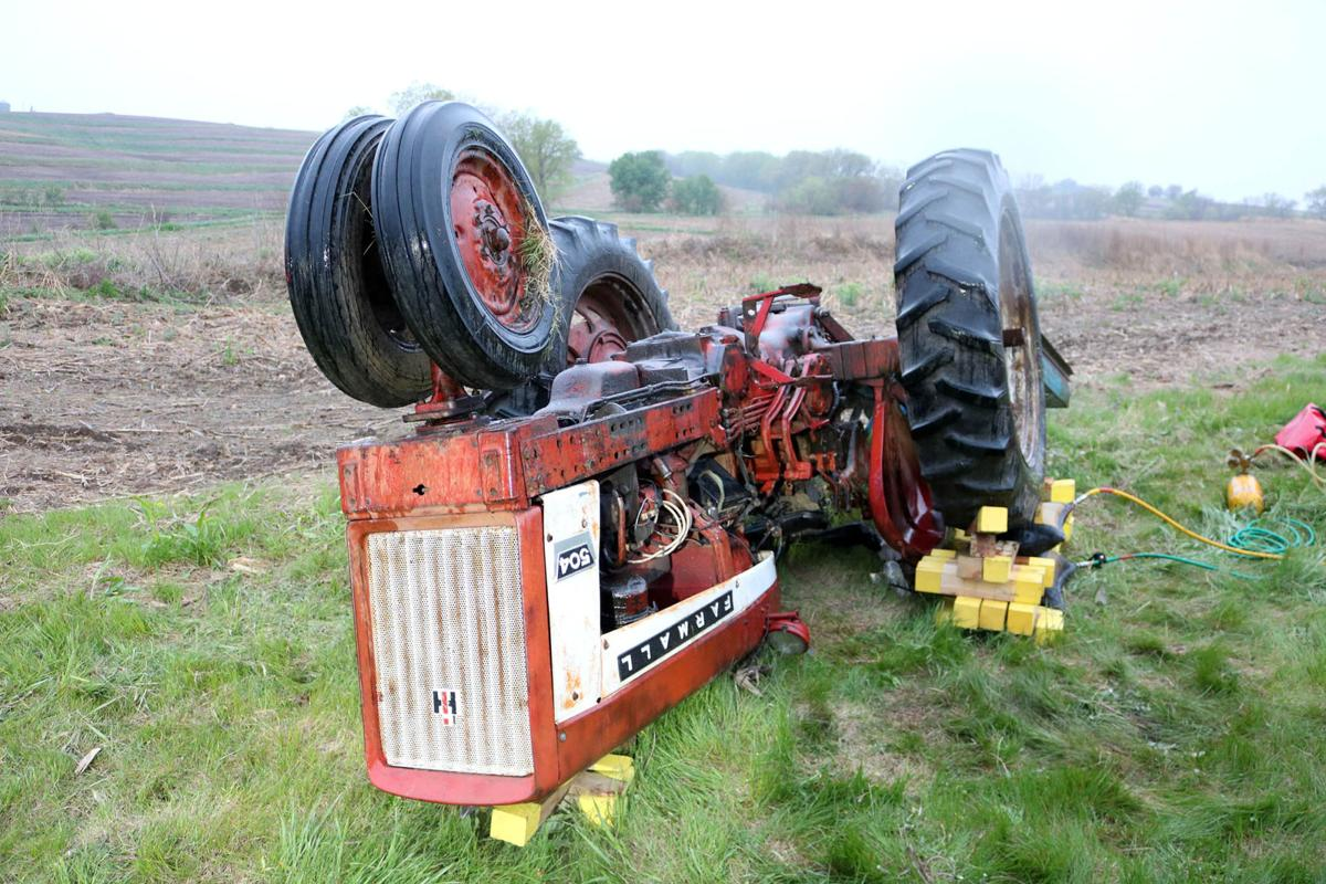 Tractor Going Right On Man : Farmall tractor roll overs bing images