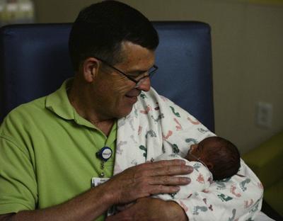 Volunteer baby cuddler helps preemie infants thrive