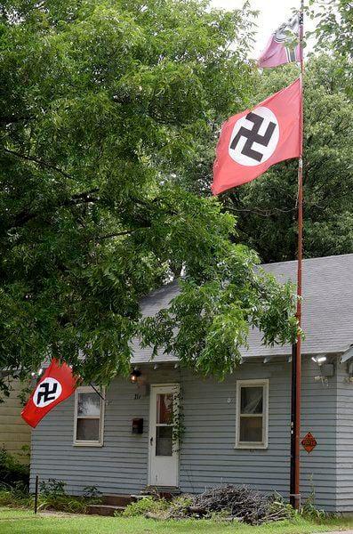 Man displaying swastikas arrested for shooting woman taking flag