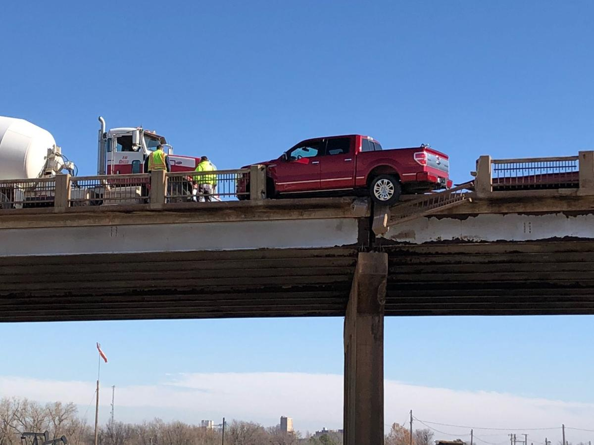 Pickup goes partially off overpass in accident