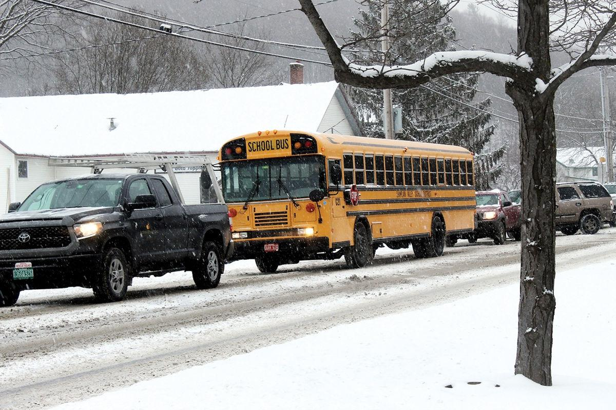 A school bus makes its way through traffic-clogged streets