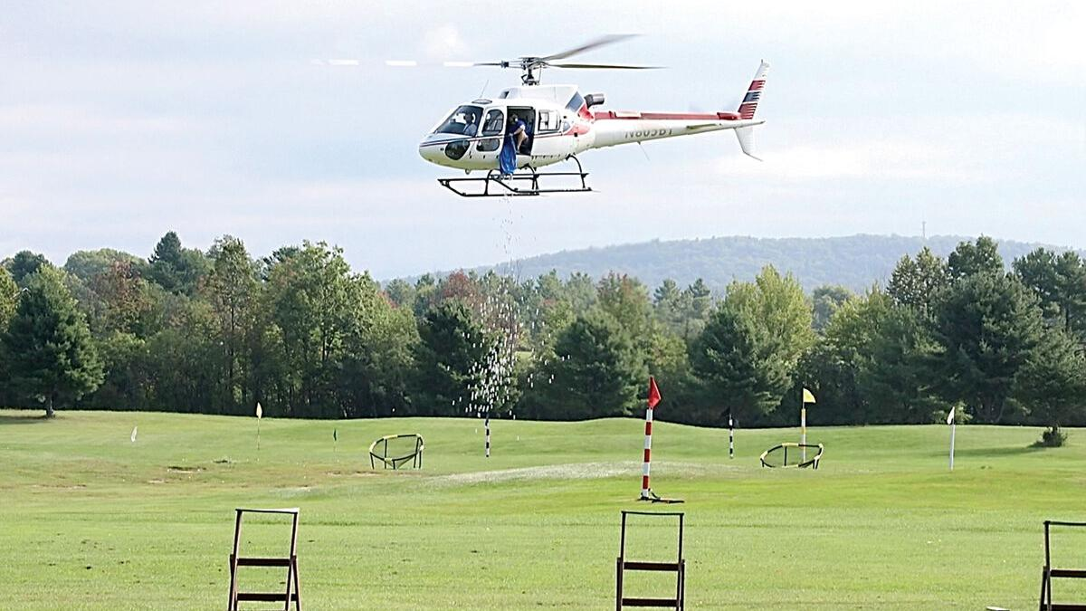 Helicopter golf ball drop raises 11K for public safety departments
