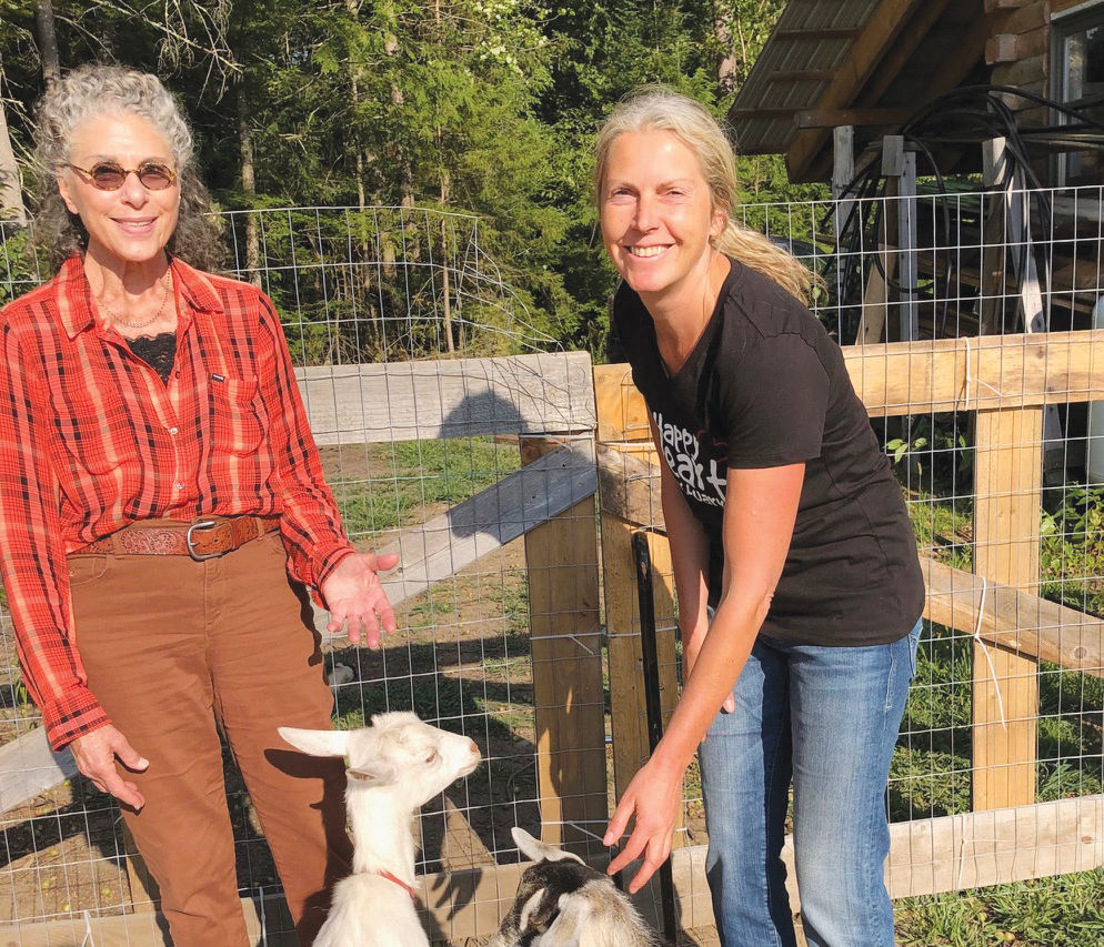 Happy Heart Sanctuary: Claudia Stauber and a volunteer