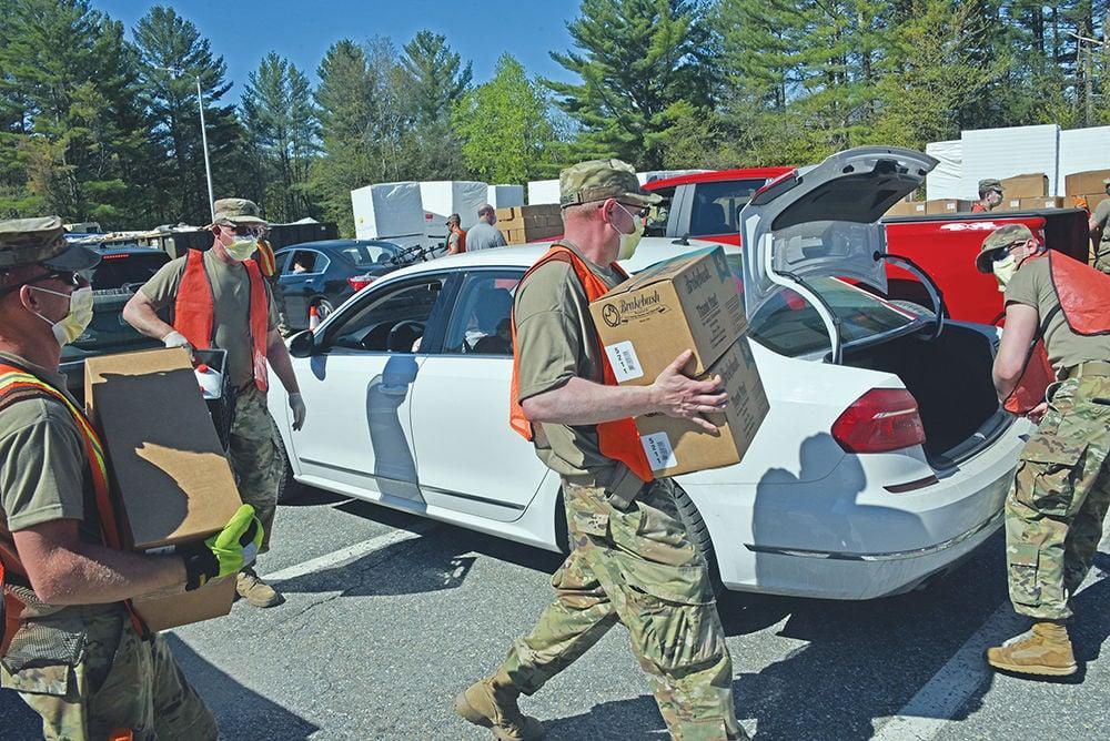 Food Bank at LUHS: National Guard members loading food