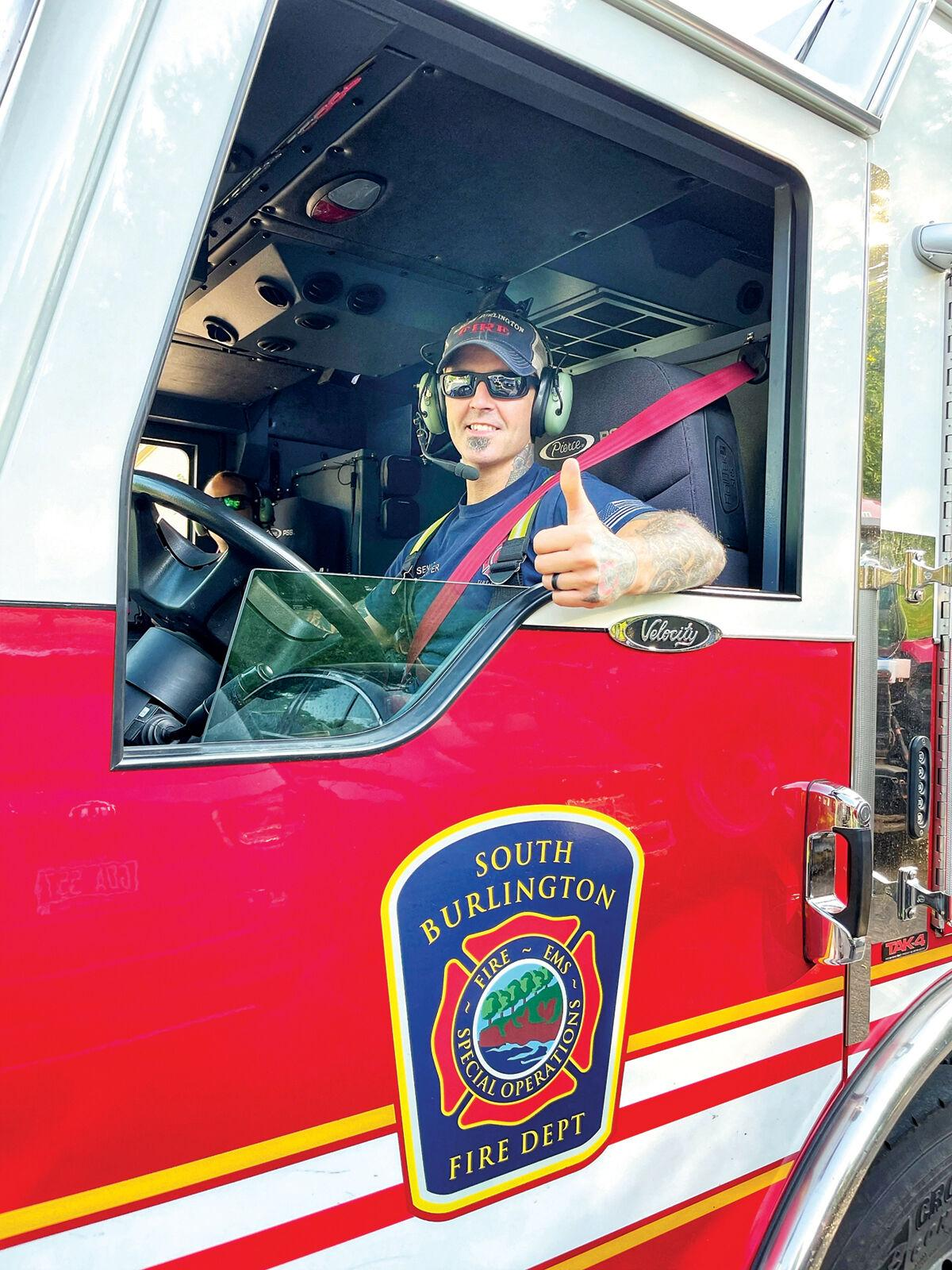 Senior firefighter Jason Cummings with his assigned truck