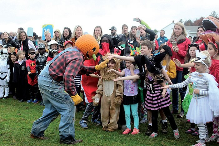 The Pumpkin Man greets students in costume