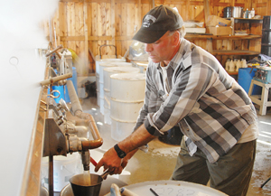 Steve Pierson boils sap at Stowe Maple Products on Route 100. The weather's been great for sugaring, with temperatures near 40 during the day and below freezing at night — excellent conditions for a sap run.