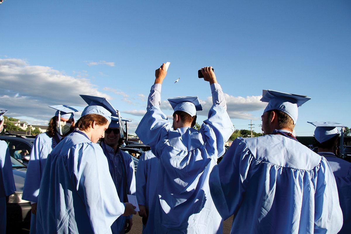 Seniors get excited as they wait to cross the stage