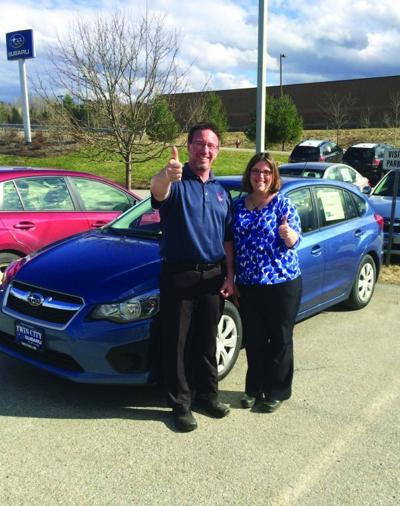 Jim Glassford of Twin City Subaru and Brynn Evans, executive director of Meals on Wheels of Lamoille County, are pictured next to a new Subaru Impreza that is being used for meal deliveries to vulnerable seniors in the farthest reaches of Lamoille County.