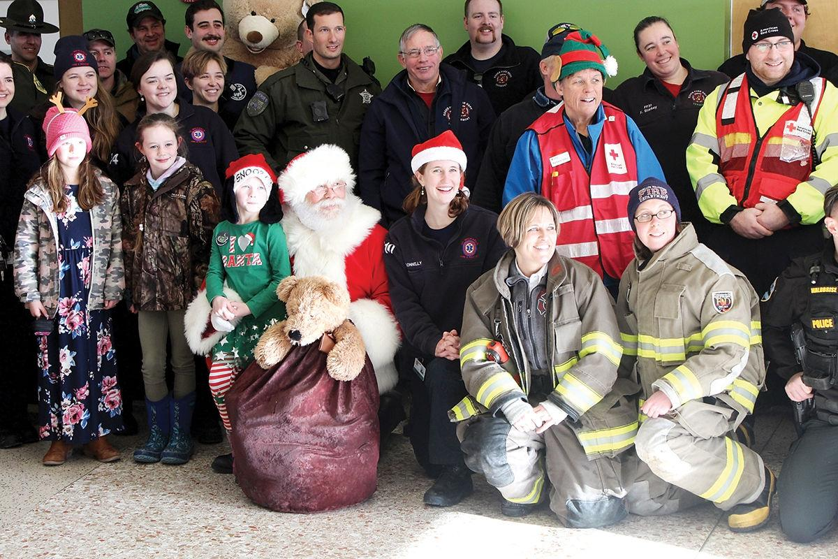 Participants in this year's Operation Firecuffs pose with Santa
