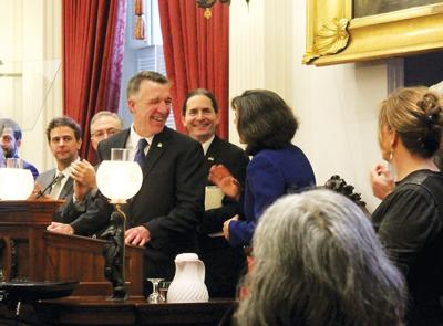 Gov. Phil Scott presides over legislators from the House and Senate