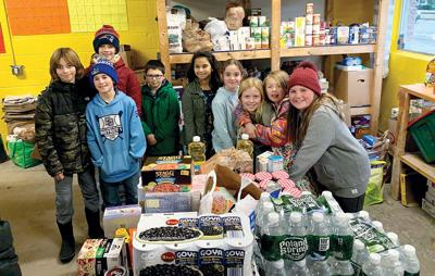 Fifth graders at Rick Marcotte Central School drop off donations