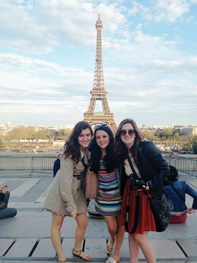 Stowe High School seniors Emma Stein, Haley Walker and Brittany Prouty pose in front of the Eiffel Tower on a school trip last month.