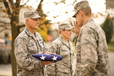 Col. David Smith with flag