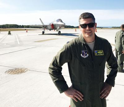 Lt. Col. Nate Graber poses in front of an F-35 fighter jet