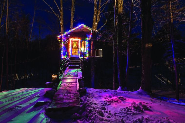 Twinkle lights illuminate Tiny Fern Forest Treehouse in Lincoln.