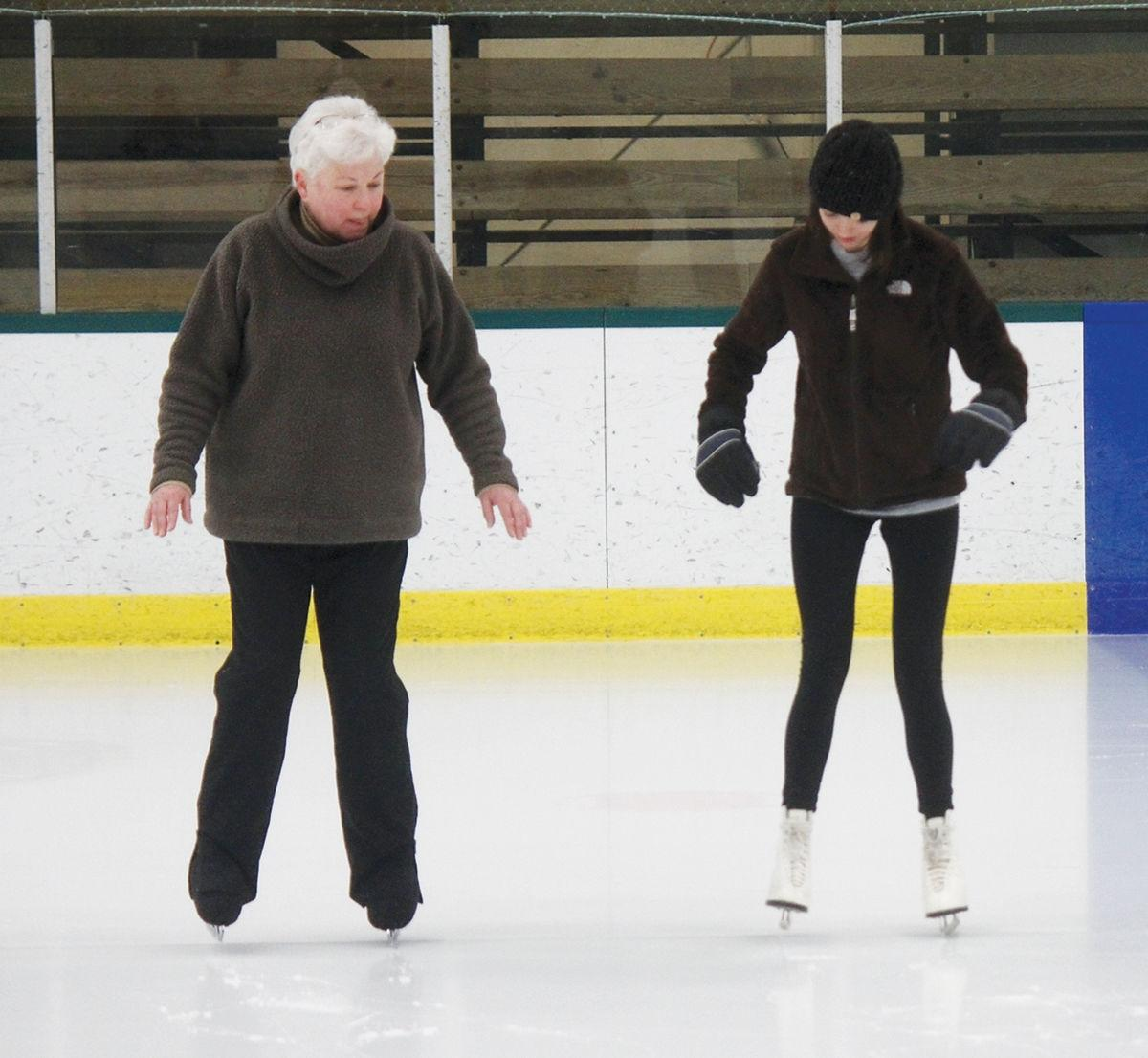 Madeline Clark takes to the ice with coach Martha Hubbard