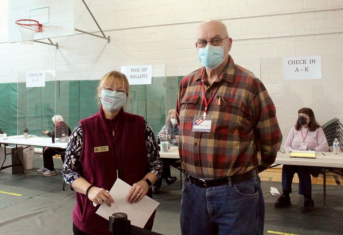 Diana Vachon with poll worker Pete Gadue