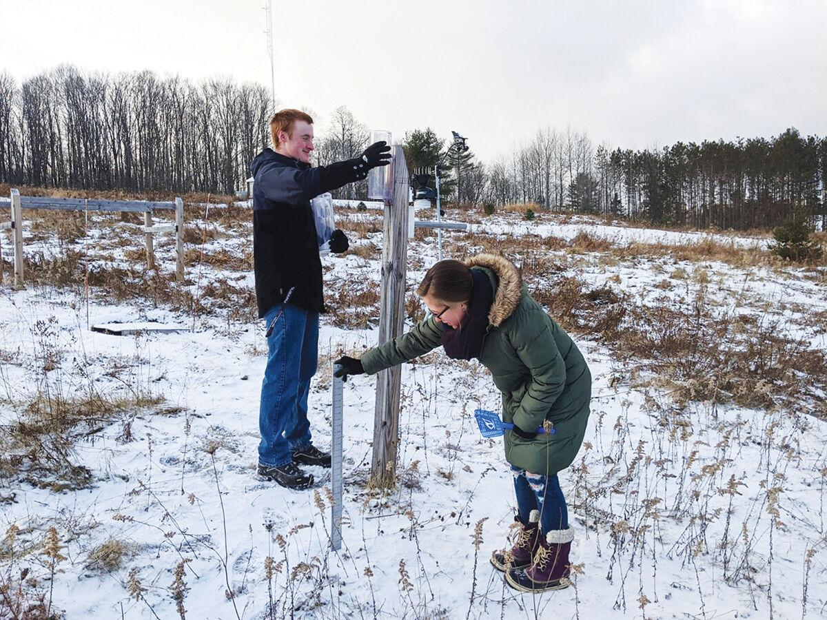 Students checking weather monitoring equipment