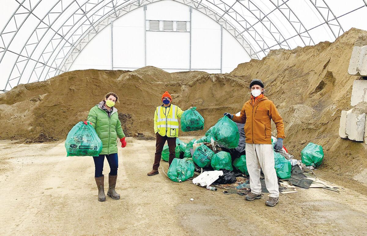 Hinesburg Conservation Commission stand with Green Up bags