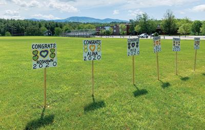 Signs posted on the school lawn