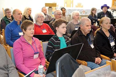 Shelburne resident Kate Hill (second from left, middle row) sings out loud during a recent Aphasia Choir rehearsal JPG_CMYK