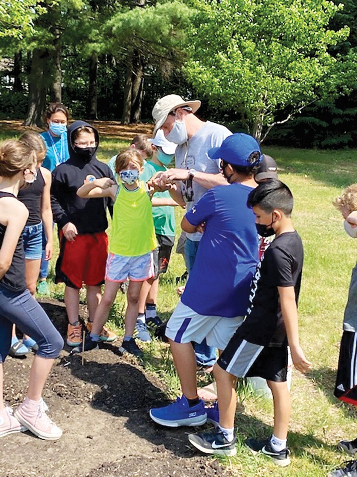 Students plant three sisters garden plot